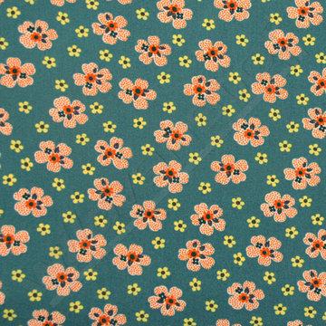 Oranje bloemen op donkergroen
