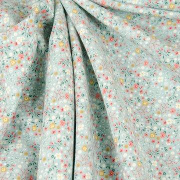 French terry - Kleine  veldbloemetjes op lichtblauw