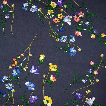 Stretch katoen - Donkergrijs met heidebloemen