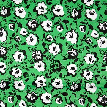 Stretchkatoen - Groen met wit geschilderd bloempje