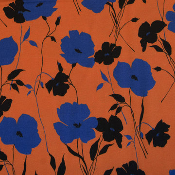 Viscose crepe - Grote blauwe bloemen op roest